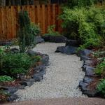 Rock edged path using recycled crushed glass..